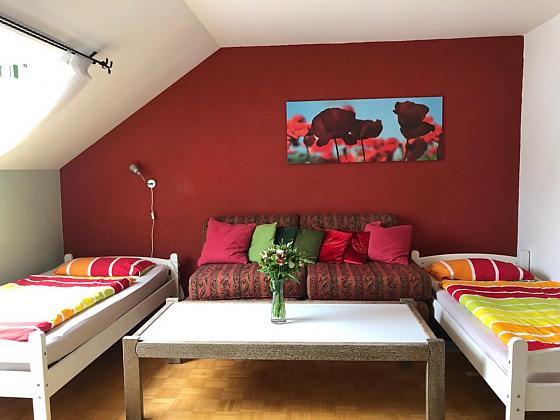 Schlafzimnmer mit 3 Einzelbetten